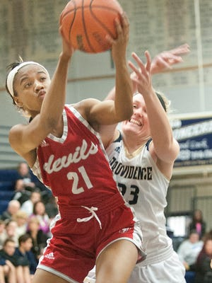 Jeffersonville guard Jhala Henry puts up a shot as Providence forward Claire Rauck defends the basket. 03 January 2017