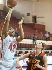 Manual center Dejah Chatman puts up a shot as Bullitt East guard Lindsey Duvall watches in the second round of the Girls LIT.25 January 2017