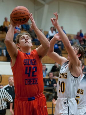 Silver Creek's Jacob Garnett puts up a shot during a 2017 game against Salem.