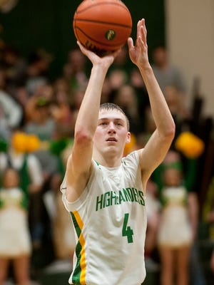 Floyd Central guard Matt Weimer puts up the final point in the game, making his second free throw in overtime, and giving the Highlanders a 61-56 win over visiting Evansville Harrison.11 February 2017
