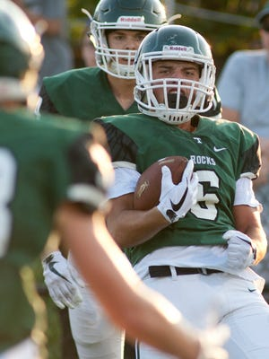 Trinity wide receiver Anthony Palomvino evades Carmel (In.) cornerback Andrew Colombo to score the game's first touchdown and celebrates in the end zone.18 August 2017