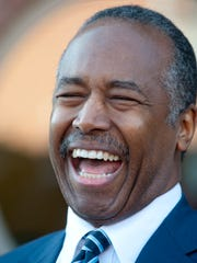 Ben Carson smiles during his visit to Louisville on Thursday.