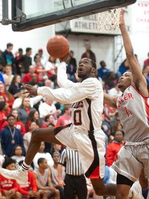 PRP guard-forward B.J. Robinson drives to the basket defended by Butler center-forward Devin Pendergrass in the 6h Regional boys basketball quarterfinals game.Feb. 27, 2018
