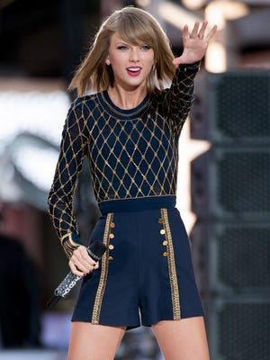 Taylor Swift, performing in Times Square last month, held on to the top spot in album sales for the second week in a row.