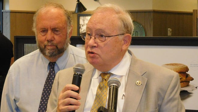 Rep. John Ager, left, listens while Dr. Frank Moretz speaks during a recent debate in the race for N.C. House District 115.