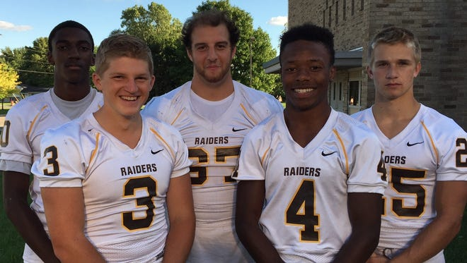 Five of North Farmington's top returning players are (left to right) seniors Bryce Gresham, Brendan Huston, Jordon Machlis, Warren Stanfield and Adam Dunning. The Raiders begin the season Friday night at Walled Lake Northern.