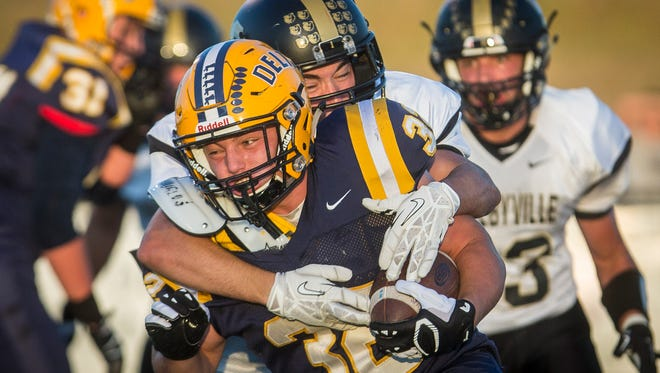 Delta's Charlie Spegal is brought down by Shelbyville Friday night at Delta High School. The game ended with a Shelbyville win 28-21.