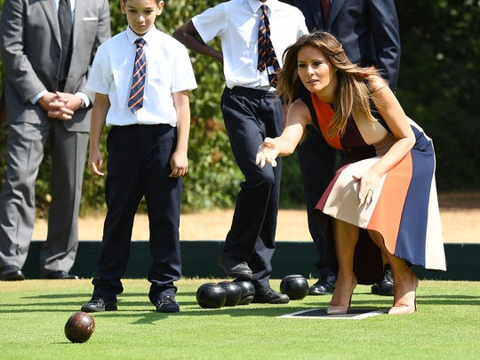 First lady Melania Trump tries her hand at bowls as she meets British Army veterans, known as Chelsea Pensioners, at Royal Hospital Chelsea on July 13, 2018 in London.