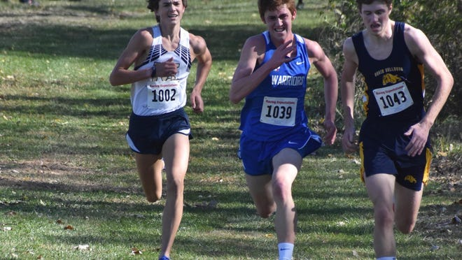 Derek Coulter, left, of Mercer County; Cross Oberman of East Dubuque and Ollie Arndt of Freeport Aquin drive hard to the finish line at the IHSA Class 1A cross country sectional on Saturday, Oct. 31, at the Seneca FFA Land Lab. Arndt finished 15th at 17:46.3, a step ahead of Oberman, 16th, 17:46.5. Coulter was on their heels in 17th place at 17:47.3. If the IHSA had a state meet this year, Arndt and Oberman would have been the last two individuals to qualify.