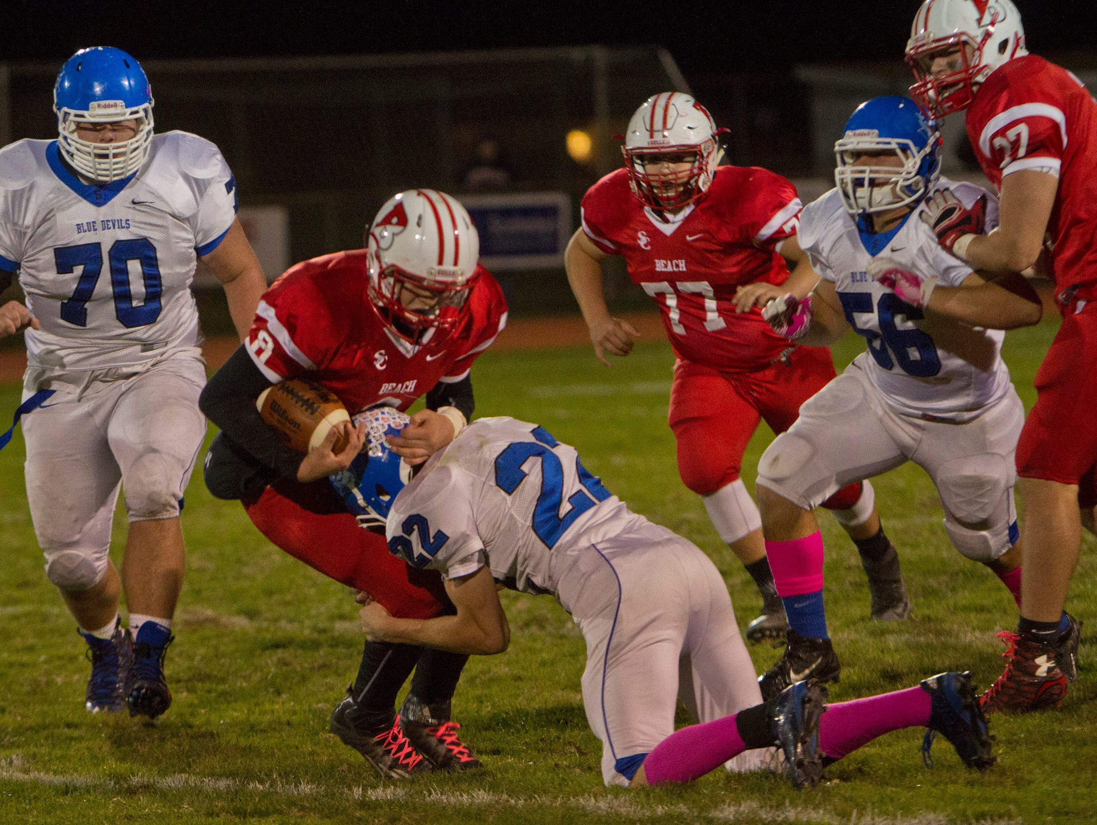 Point Beach's John Nista gets tackled by Shore Regional's Alex Johnson during first half action. Shore Regional football vs Point Pleasant Beach in Point Pleasant Beach on October 30, 2015.