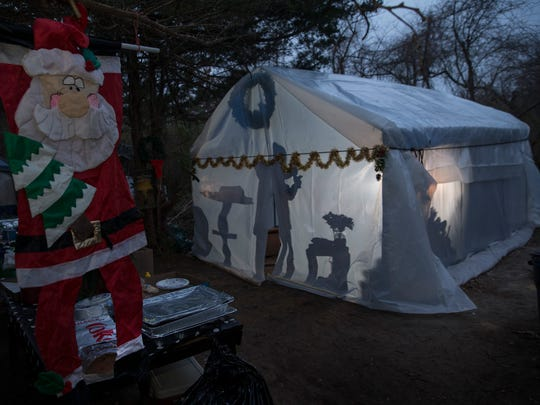 As the temperature continues to drop and winter approaches, even the small chapel is covered in plastic and supplied with a heater to keep the homeless warm when they gather together. The campers decorate the camp communal area for the holidays.