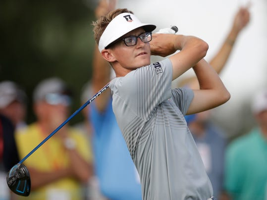 Dylan Meyer drives off the 17th tee during a quarterfinal round of the U.S. Amateur golf tournament at Oakland Hills Country Club, Friday, Aug. 19, 2016, in Bloomfield Township, Mich. (AP Photo/Carlos Osorio)