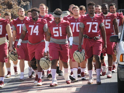 The FSU offensive line walks in for the beginning of
