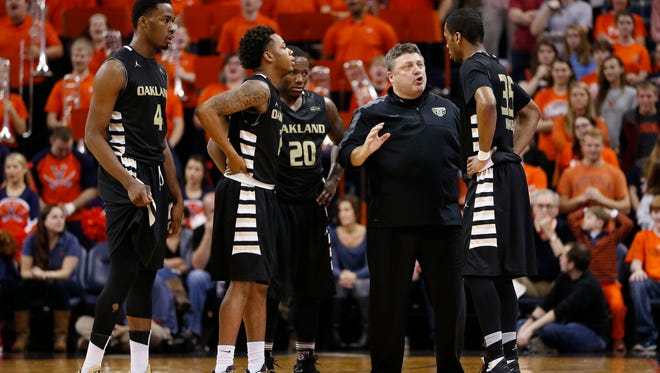 Oakland coach Greg Kampe for years put his team through a gauntlet with its nonleague schedule, including to some degree last season when the Golden Grizzlies played at Virginia (pictured) a week after facing MSU. This year, he's taking a different approach, valueing wins over strength of schedule.