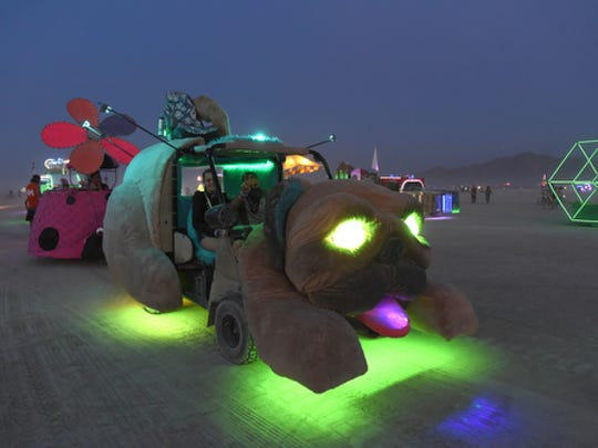 Mutant vehicles line up to be registered at the DMV on the playa during Burning Man in 2016.
