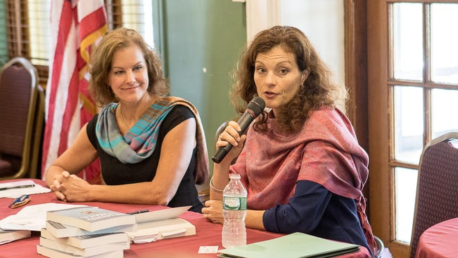 "Sisters, Elin (left) and Mary Widdifield, authors of ""Behind the Wall: The True Story of Mental Illness as Told by Parents,"" talks for the Morris County chapter of the National Alliance on Mental Illness at St. Francis Resiential Community in Denville on Monday."
