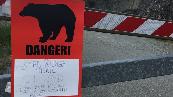 A sign warns people that the trail head is closed, June 19, 2017, after a fatal bear mauling at Bird Ridge Trail in Anchorage, Alaska.