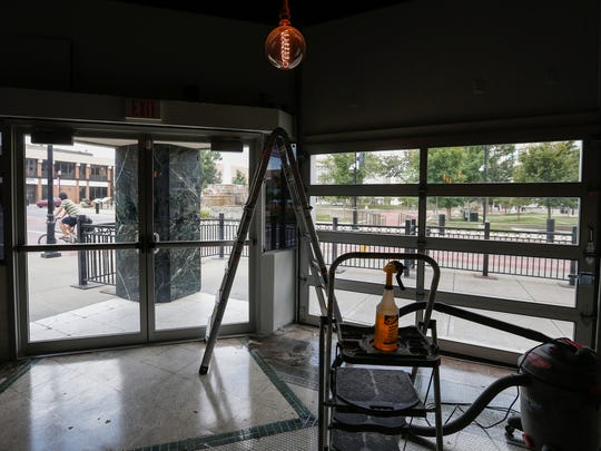 The owner of The Wine Dive installed a pair of garage doors to open up the space that was housed the Blue Bull restaurant on Park Central Square. It is expected to open sometime between August and October.