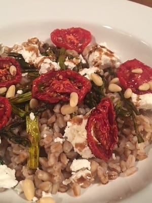 A farro salad with goat cheese and pine nuts.