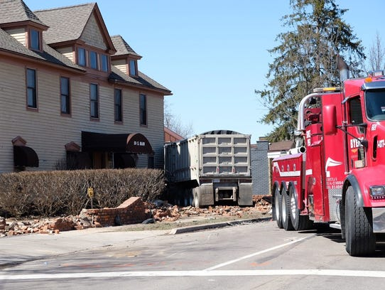A truck driver crashed his rig into a building Friday