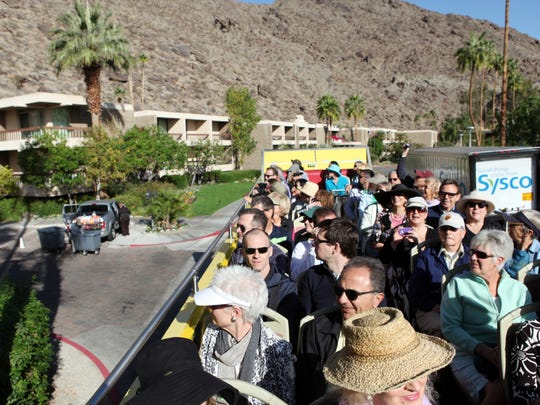 The double-decker bus tour of mid-century modern architecture makes it way pass the Tennis Club District during Modernism Week on Feb. 21 in Palm Springs.