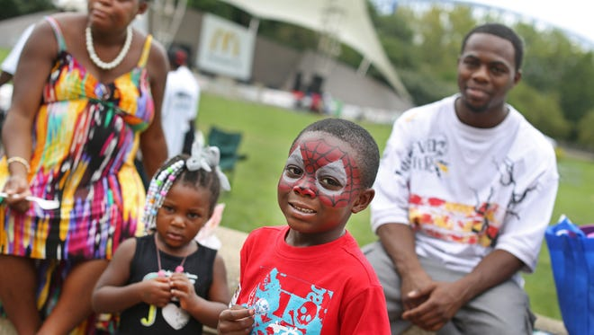 RJ Byrd, of Westwood, sports a Spider Man face, as he enjoys the 26th Annual Midwest Black Family Reunion at Sawyer Point. He's with his mom and dad, Dea and Ronshay and his sister Shamir.