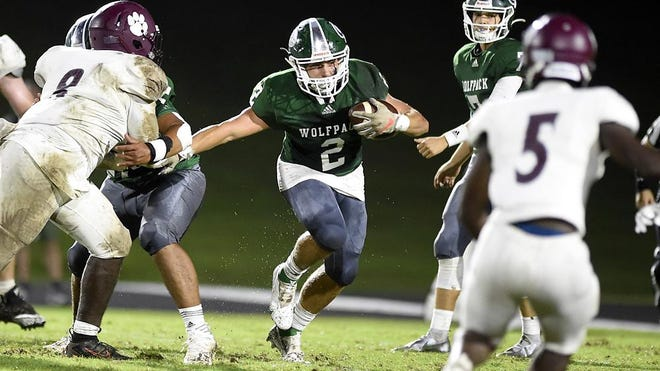 Greenbrier's Wilkes Riggins looks for a hole in the Lakeside defense to run through during football action at Greenbrier High School in Evans, Ga., Friday evening Sept. 18, 2020
