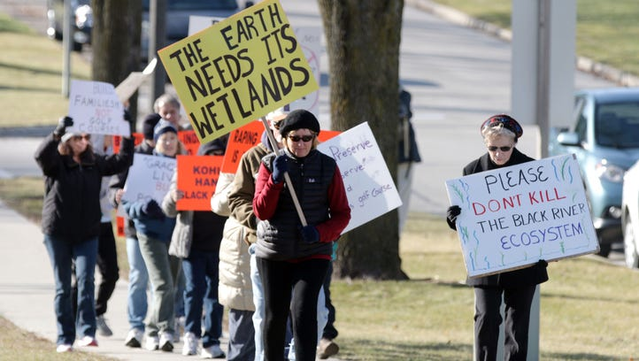 Friends of the Black River Forest walked in protest in Kohler Saturday December 5, 2015 in Kohler. The group is protesting the development of land near Kohler-Andre Park as a golf course.