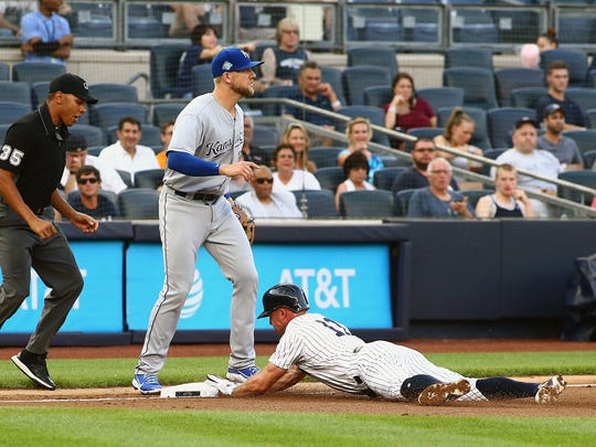 New York Yankees center fielder Brett Gardner (11) slides safely into third base against the Kansas City Royals during the first inning during game two of a doubleheader at Yankee Stadium.