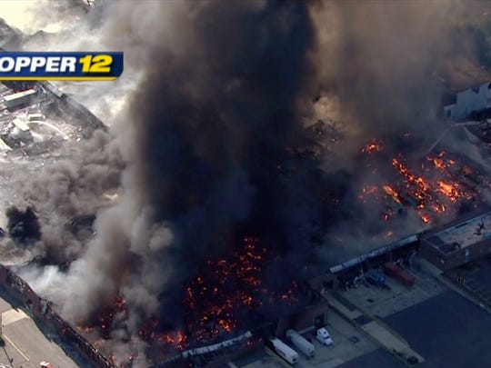 Images from News 12's helicopter shows the North Brunswick warehouse fire scene on Wednesday.