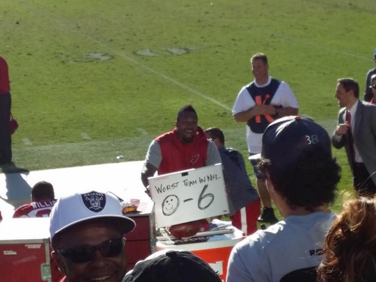 Darnell Dockett held up an 0-6 sign at Raiders fans.