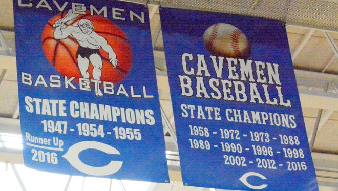 Carlsbad celebrates the new boys basketball and baseball state banners Wednesday at the CHS Gym.