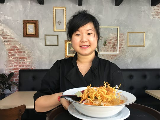 Tata Lawton poses with kao-soi shrimp at Prawn & Basil
