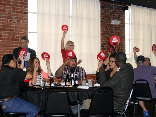 Attendees at the 2015 Progressive Dinner Fundraiser raised their fan to show they were ready for the next course.