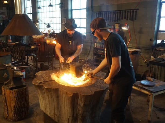 The Knapp family works in their Milwaukee Blacksmith shop in the Third Ward.
