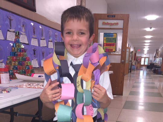 Kindergarten student Martin Lang with his project of
