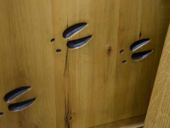 Deer tracks add detail to a custom door Thursday, Aug.