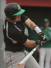 Margaretta's Simon Kromer swing at a pitch during the