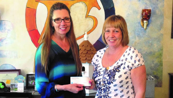 Diane Ploch (right) presented Donna Bennett, president and CEO of Big Brothers Big Sisters of Cumberland & Salem Counties, with a $7,000 donation.