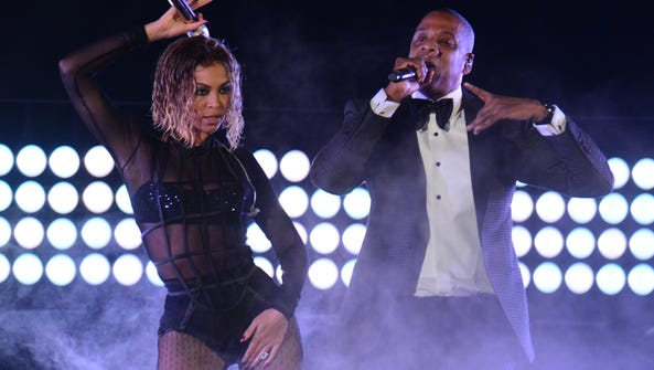 Beyonce Knowles and Jay-Z perform on stage for the