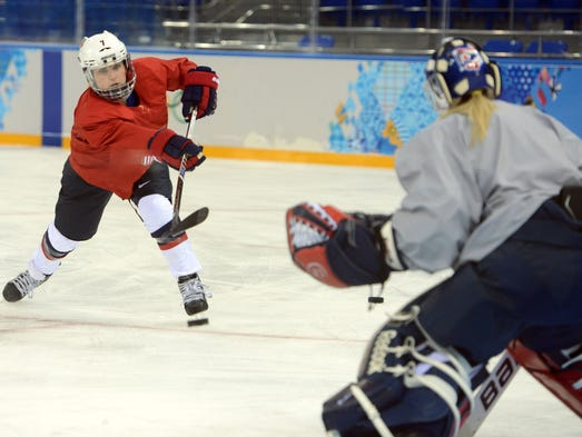 USA forward Monique Lamoureux (7) shoots during a practice session in preparation for the 2014 Sochi Olympic Winter Games at Shayba Arena.