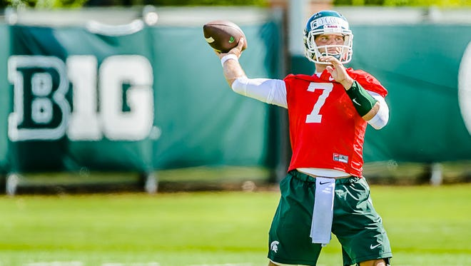 Senior Tyler O'Connor participates in a passing drill during the first practice of MSU football fall camp Saturday. O'Connor begins August as the heavy favorite to be this year's starting quarterback.