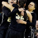 Purdue forward Whitney Bays (32) celebrates with forward Liza Clemons, left, and guard Ashley Morrissette after Purdue defeated Wisconsin 58-56 during an NCAA college basketball game in the Big Ten women's tournament in Hoffman Estates, Ill., on Wednesday, March 4, 2015. (AP Photo/Nam Y. Huh)