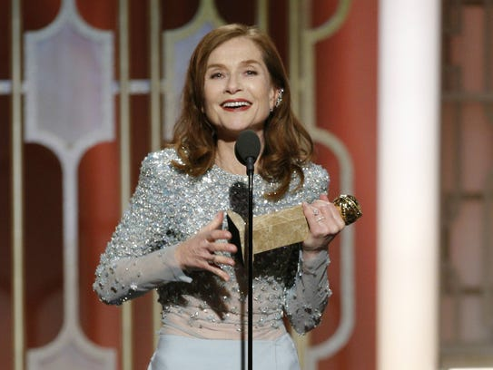 Isabelle Huppert accepts the Golden Globe for best