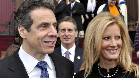 This  Jan. 2, 2011 file photo shows New York Gov. Andrew Cuomo, left, with his girlfriend, Sandra Lee, and Lt. Gov. Robert Duffy, center, in 2011.