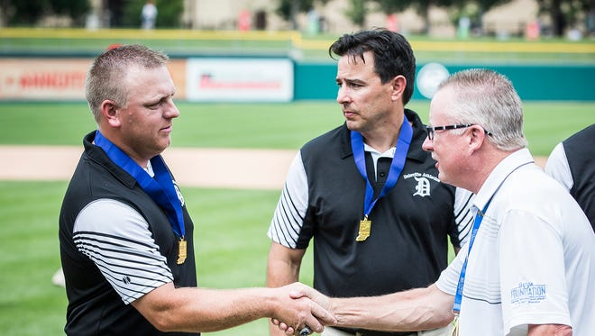 Daleville's Daniel Hanson, left, shakes hands with IHSAA commissioner Bobby Cox after the Broncos defeated University in their state final game at Victory Field Saturday, June 16, 2018.