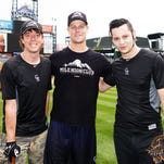 Shaun Hagglund, left, works with former Twins star Justin Morneau during an autograph signing. Morneau gave Hagglund his first big break in becoming a promoter of fan websites and promotional events and materials for professional athletes.