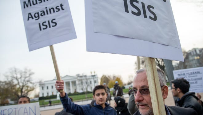 Shiite Muslims rally for peace outside of the White House in Washington, Sunday. That night, President Barack Obama addressed the nation from the Oval Office night about the steps the government is taking to keep the American people safe.