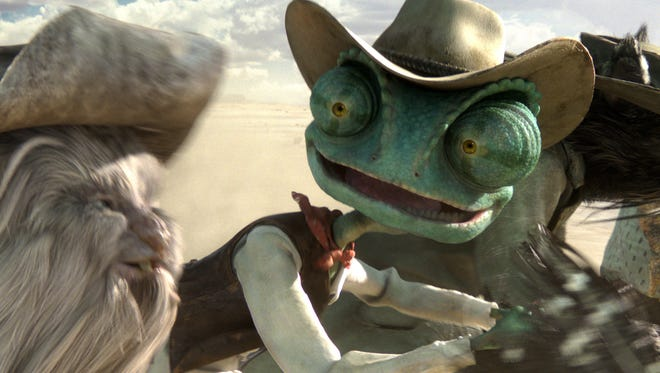 """Johnny Depp provides the voice of Rango, a chameleon who becomes a reluctant hero in an old Western town, in the animated movie """"Rango."""""""