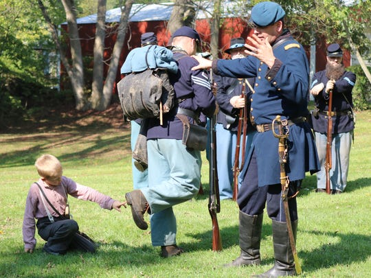 Brian Porter, of the 14th Ohio Volunteer Infantry re-enactors, discussed the typical outfitting of a Union soldier.